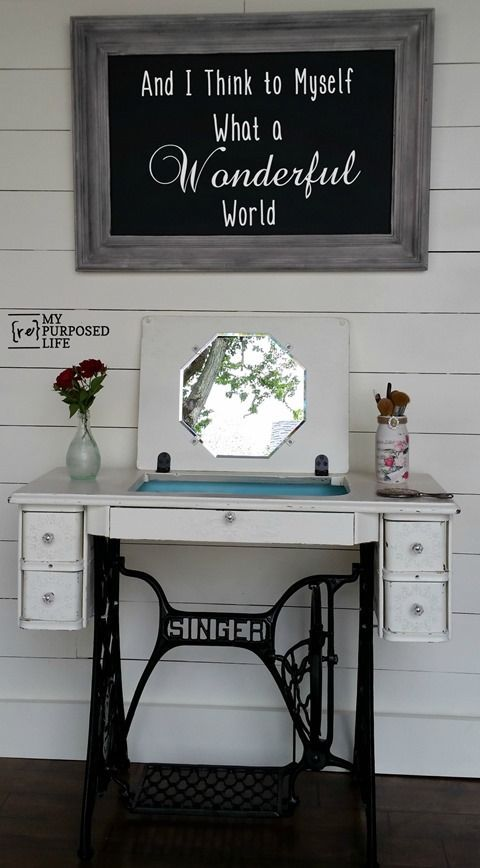 This repurposed sewing table is a triple threat – it's a table, it's a desk, and it also opens up to serve as a vanity complete with hidden makeup storage and a mirror.