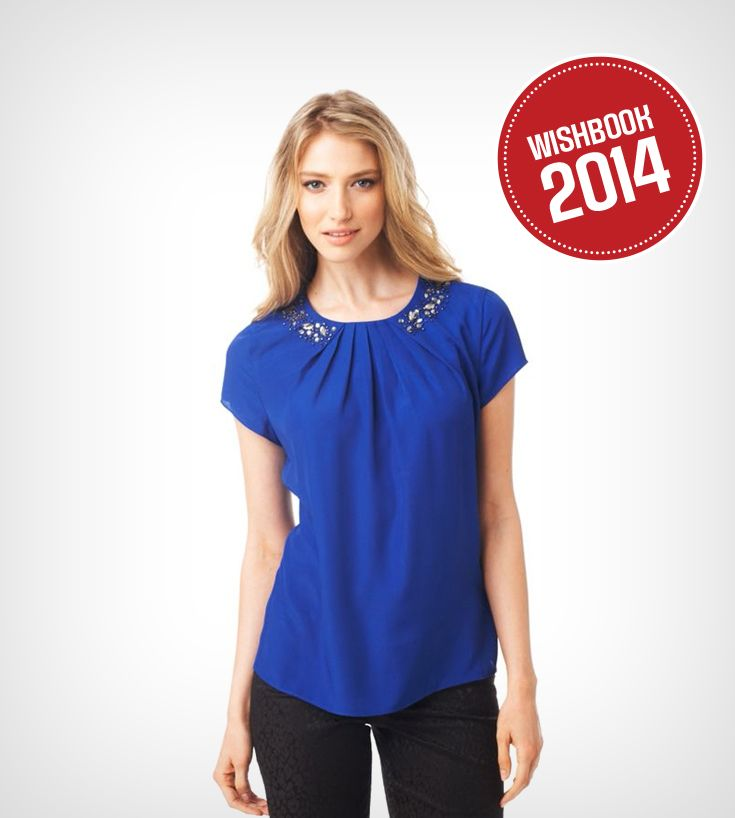 A bright top with an embellished neckline is perfect for holiday parties, work or going out