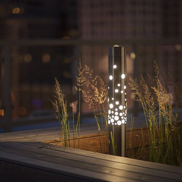 Outdoor lighting light column bollard shown in stainless steel with satin finish with 360 degree bubbles shield at one prudential plaza rooftop deck
