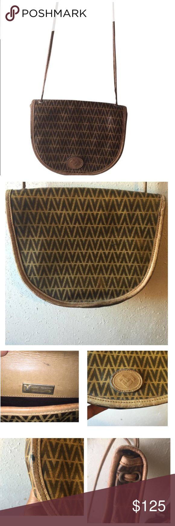 💥Vintage Valentino Monogram Small Crossbody💥 This is a lovely small Valentino Crossbody. It's vintage, don't know the exact year. Used to belong to my mom. Does have a small ink stain ( see photo ) Selling due to financial reasons. Feel free to ask me questions as all my sales are final, I need the money for bills. Thanks for watching. ! Please make me offers. Valentino Bags Crossbody Bags