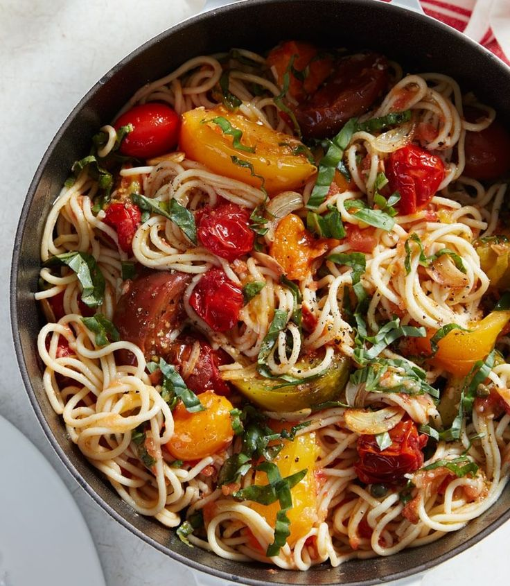 Spaghetti with Fresh Tomatoes and Basil | Once tomato season hits, you'll want to jump on the opportunity to make our test kitchen's fresh pasta with heirloom tomatoes straight from the garden.