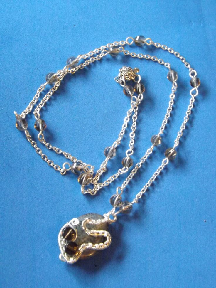 Agate wire wrapped pendant on a smoky quartz chain