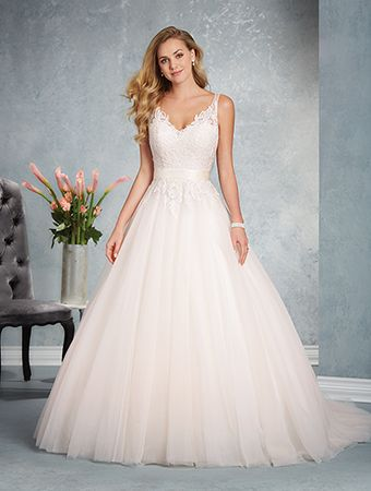 A traditional wedding dress with a sweetheart neckline, shoulder straps, sheer back yoke, A-line skirt, and chapel train.