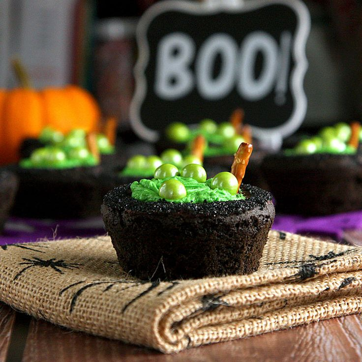 Double, double, toil and trouble, fire burn and cauldron bubble...these cauldron cookie cups are the perfect recipe for a Halloween party or bake sale!