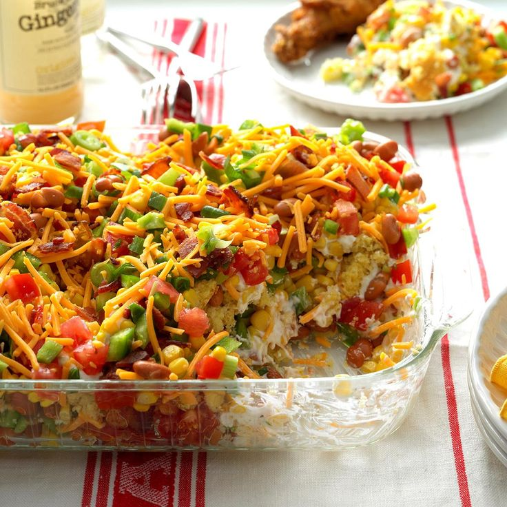 Chili Corn Bread Salad Recipe -A co-worker brought this wonderful dish to a potluck several years ago. She had copies of the recipe next to the pan. Now I make it for get-togethers and also supply copies of the recipe. I never have any leftover salad!!