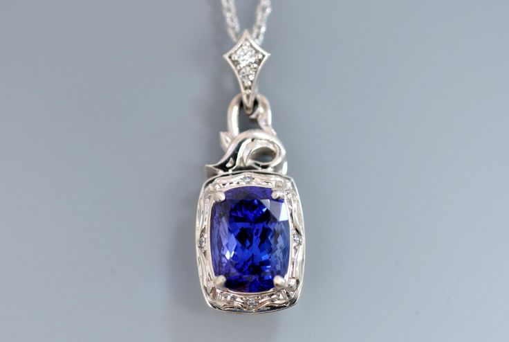 Blue Ceylon #sapphire in white gold with hand engraving by Alex Gulko