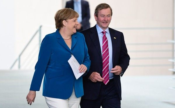 Angela Merkel Photos Photos - German Chancellor Angela Merkel (L) and Irish Prime Minister Enda Kenny arrive to address a joint news conference at the chancellery in Berlin on July 12, 2016. / AFP / John MACDOUGALL - Merkel, Kenny Want Britain's May to Quickly Define EU Ties