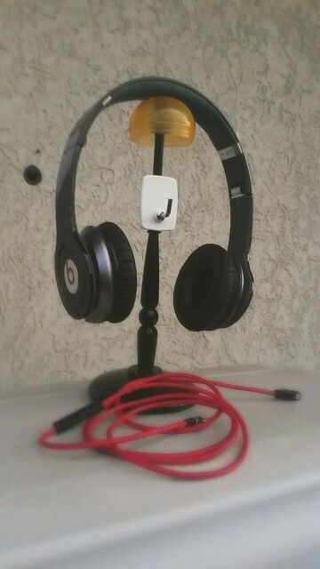 Super easy DIY headphone holder-stand which you can use even to keep your cable! Homemade really really easy with hot glue.