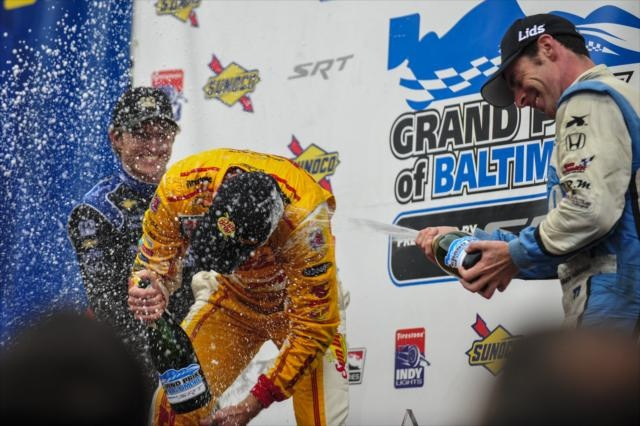 Ryan Briscoe, Ryan Hunter-Reay, Simon Pagenaud in the Sunoco Victory Circle at the Grand Prix of Baltimore.