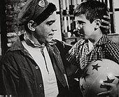 1956; El Bolero De Raquel. Original Film Title: El Bolero De Raquel, PICTURED: MARIO MORENO ''CANTINFLAS'', PAQUITO - Stock Photo
