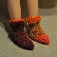 I looked everywhere for a knit sock pattern for my new Bythe doll, Simone. It had to be on US1 needles (like a real human sock) and had to h...