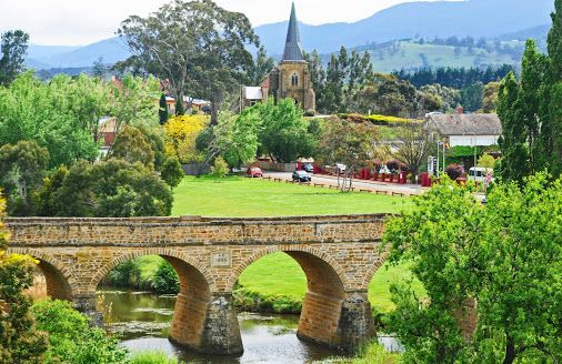 The historic town of Richmond, with Australia's oldest bridge (1823) and oldest Catholic church still in use (St John's - 1837). #richmond #tasmania #discovertasmania Image Credit: Greg Vance Photography