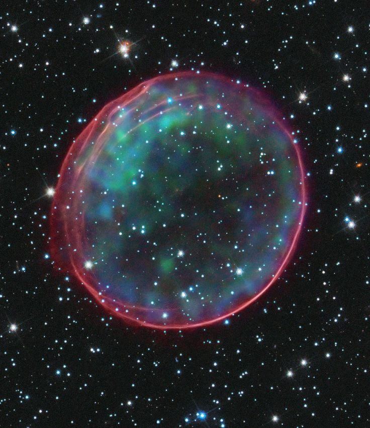 SNR 0509-67.5, a type Ia supernova, and the result of a supernova that occurred nearly 400 years ago for Earth viewers. The supernova remnant lies in the Large Magellanic Cloud (LMC), a small galaxy about 170,000 light-years from Earth. The bubble-shaped shroud of gas is 23 light-years across and is expanding at more than 11 million miles per hour (5,000 kilometers per second).