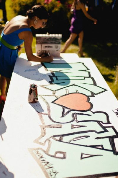 Hire a friend or graffiti artist to make a custom piece of artwork for your wedding that guests can sign!