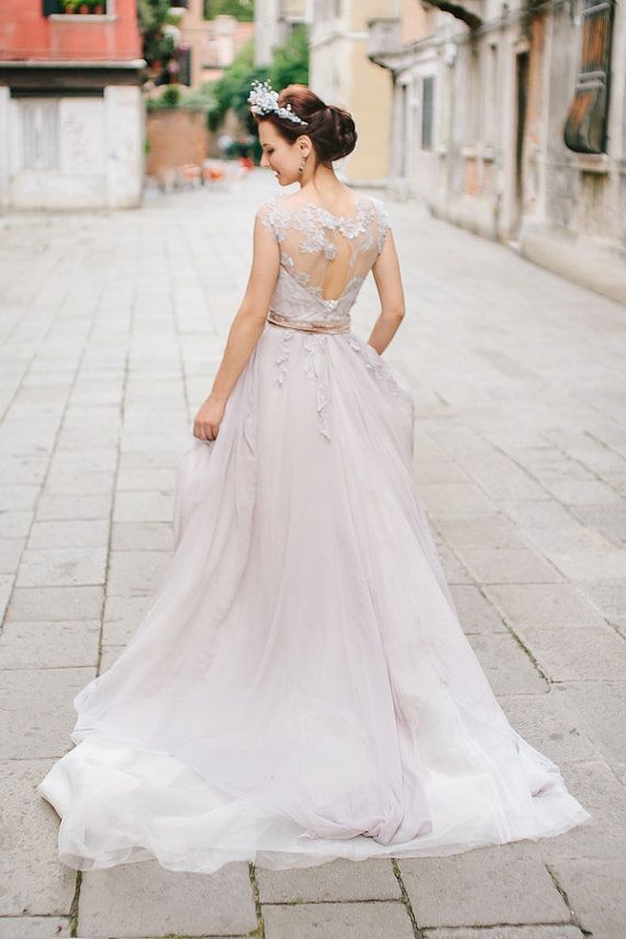 lavender shade lace wedding dress / http://www.deerpearlflowers.com/unique-sophisticated-wedding-dresses-from-cathy-telle/2/