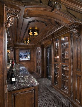 Custom stained Alder bar cabinetry by Bess Jones Interiors via Houzz feature traditional styling