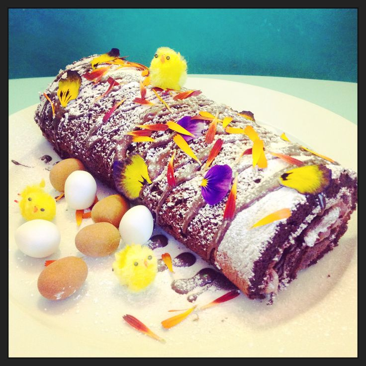 easter chocolate swiss roll complete with edible flower petals available from greensofdevon.com