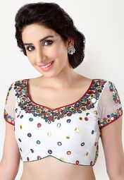 Salwar Studio brings to you this stylish white coloured blouse, which can be clubbed with a wide range of cotton and printed sarees. This embellished blouse is made from net, which makes it soft against the skin and comfortable to wear all day long.