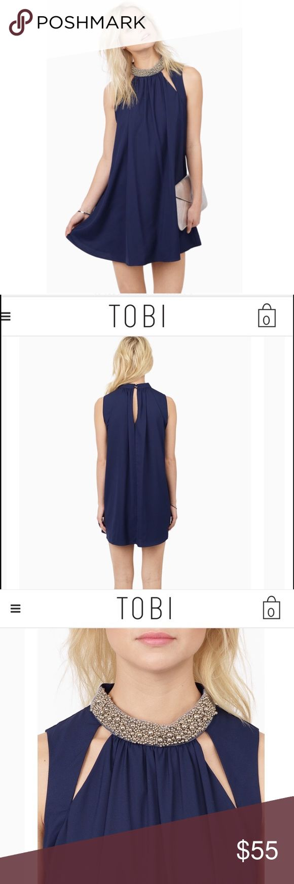 New navy trapeze dress from Tobi Brand new baby trapeze dress. Embellishments at collar. Either casual or dressy. Tobi Dresses Mini