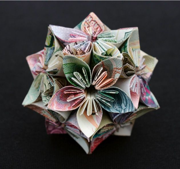 "Polyhedra Series - Honeysuckle  2008  8 bills of foreign currency (Cambodia, China, Costa Rica,  Afghanistan, Yugoslavia, Russia, Brazil, Peru)  2.3"" x 2.3"" x 2.3"""