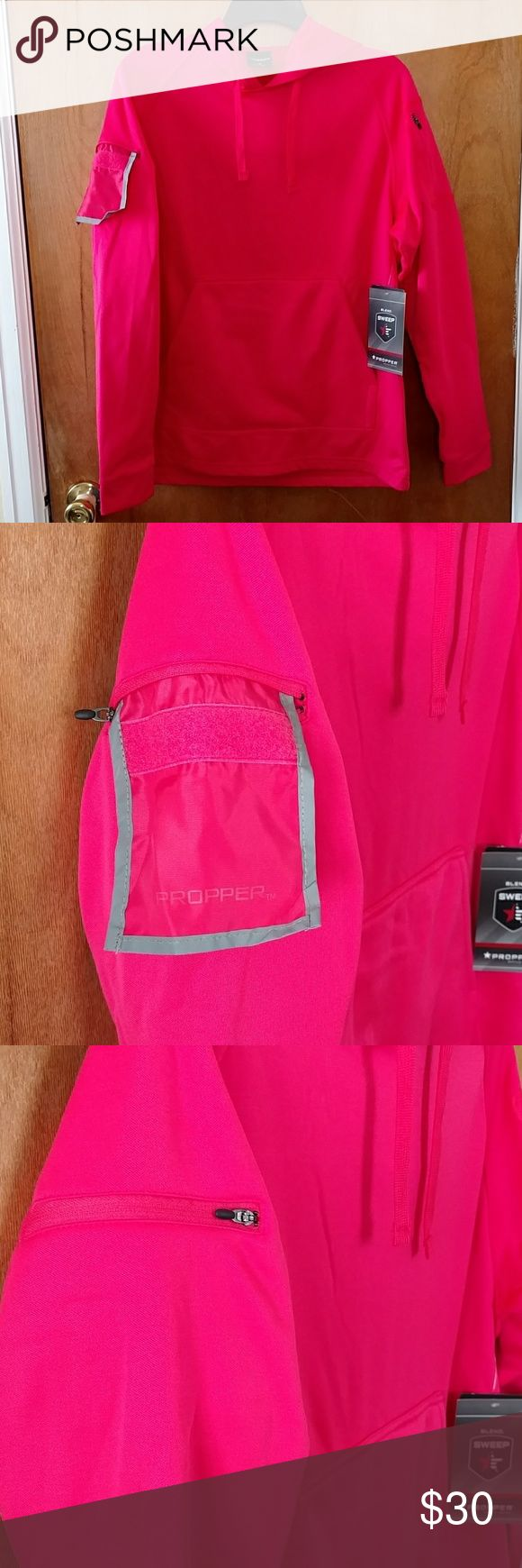 🎆 50% Off! Propper Conceal Carry Hoodie Hot Pink Use the offer button to only pay 50%! See my sale listing for more details.  Hot pink conceal carry hoodie by Propper. Marsupial pocket has two magnetic openings to discretely retrieve your concealed firearm. Right arm features a pull out ID badge panel which can be zipped closed. Left arm has two zipper pockets. Thumb holes, hood and drawstrings. Color is hot pink. Brand new, no flaws. From a smoke free, pet free home. Propper Tops…