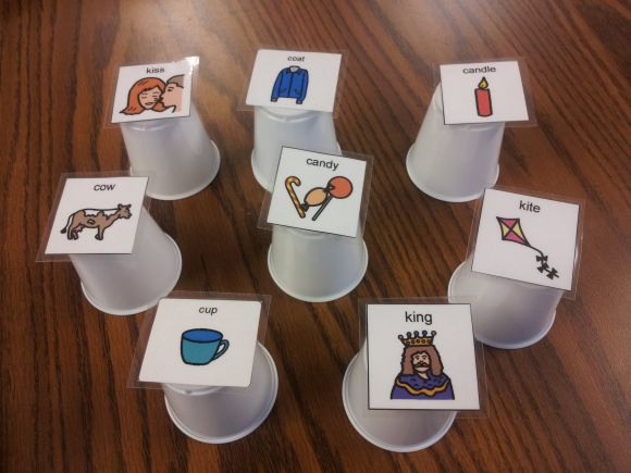 """Cups with target words. Hide things under cups. """"Is it under the ____?"""" to target in phrases/sentences."""