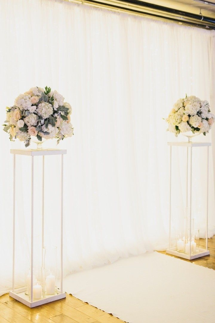 Elegant yet timeless, love the color and floral decor of this wedding ceremony! photo: GH Kim Photography