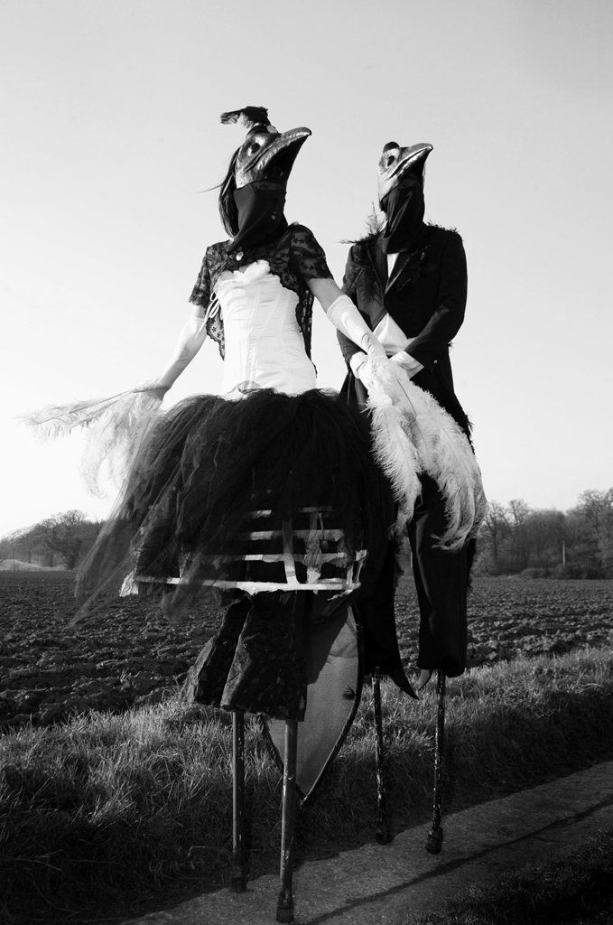 Magpies - Stilt Walkers cool gothic, steampunk style circus street performers isnt it great to see a real fashion magazine style photograph of this