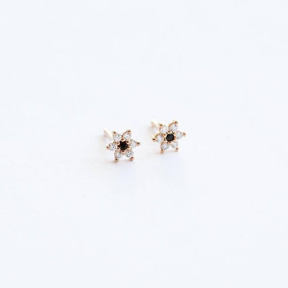 Flower studs earrings. These tiny studs are so dainty and versatile. Wear them alone or paired with other tiny studs. They also look gorgeous on as cartilage earrings. *Price is per one pair of flower stud earrings. .................... MATERIAL:  Gold Plated:  750/000 gold 18 karat plated brass. ( 3 microns ) The last coat of finishing is made from 980/000 gold, which prevents oxidation. Without nickel or cadmium - which makes it hypoallergenic. #afflink