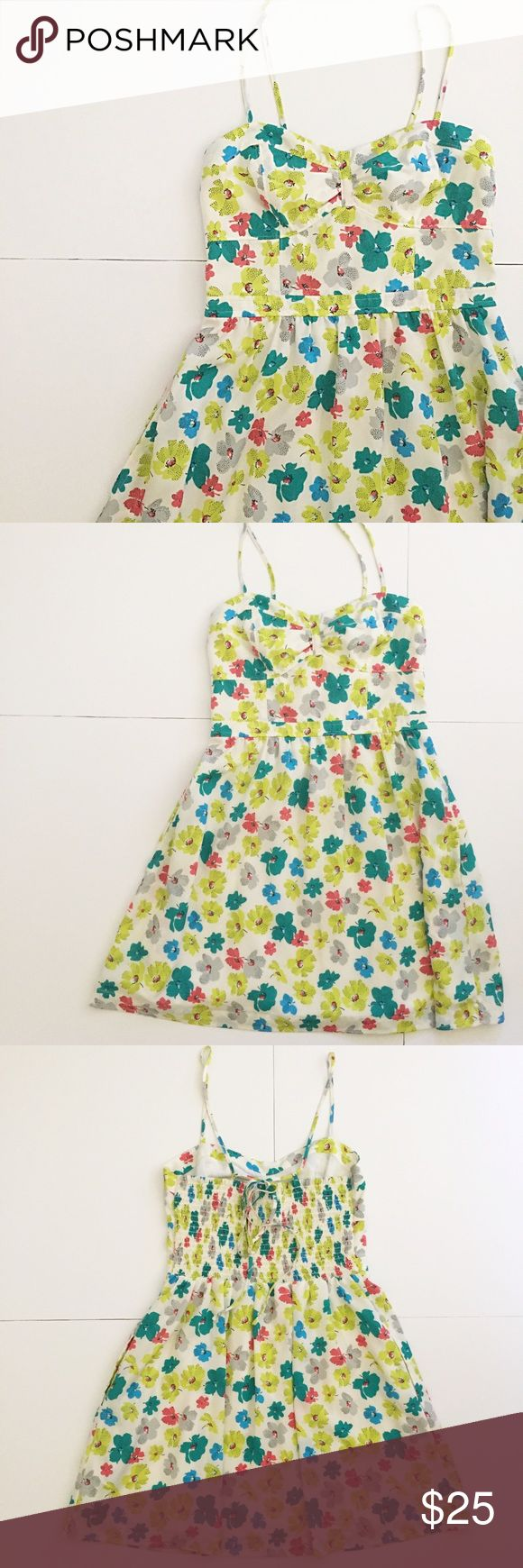 "American Eagle Floral Spaghetti Strap Mini Dress Beautiful dress from American Eagle Outfitters! Spaghetti Strap! Colors are white overall with blue, green, Lemon lime green/yellow, gray/grey, and pink flower print. Size 6. Bustier style top! Has a defined waist. Straps are completely adjustable & are controlled by a tie in the back- make it whatever length you need! 26 1/4"" long from top of cup to hem, 14 1/2"" pit to pit, waist 13 1/4"" across, hem 26 3/4"". The back has a Ribbed part that is…"