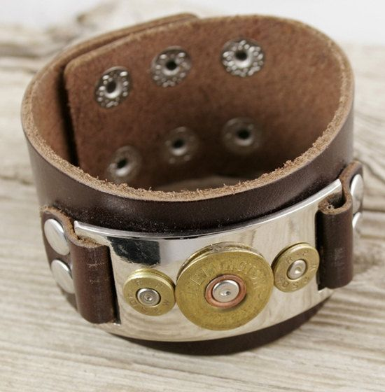 "Our 3 Bullet Leather Bracelet is made from an authentic fired shotgun bullet head and two fired 40 Caliber bullet heads. 9 in length. 1 5/8 wide. Adjusts to four different sizes.    Bullet Design, Inc. (""BDI"") products are created from bullets that have been fired, recycled and handcrafted into jewelry. Dimensions are approximate and sizes or colors may vary slightly due to the characteristics of handmade products. Please verify the correct shipping address before making your payment. If we…"