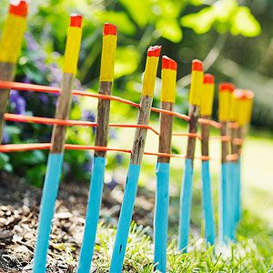 "Have kids paint 14""-18""-long sticks and hammer them into the ground about 3"" apart with a rubber mallet. Weave thin nylon rope through them to create a colorful border for your garden."