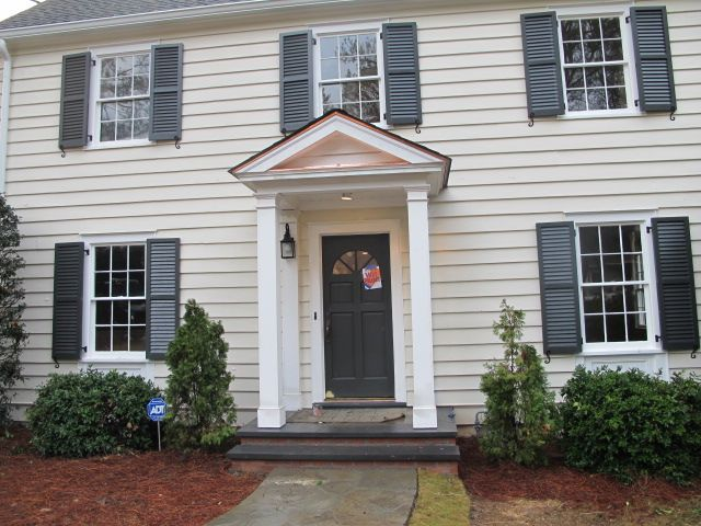The shutters and front door [along with the stair railings inside] are
