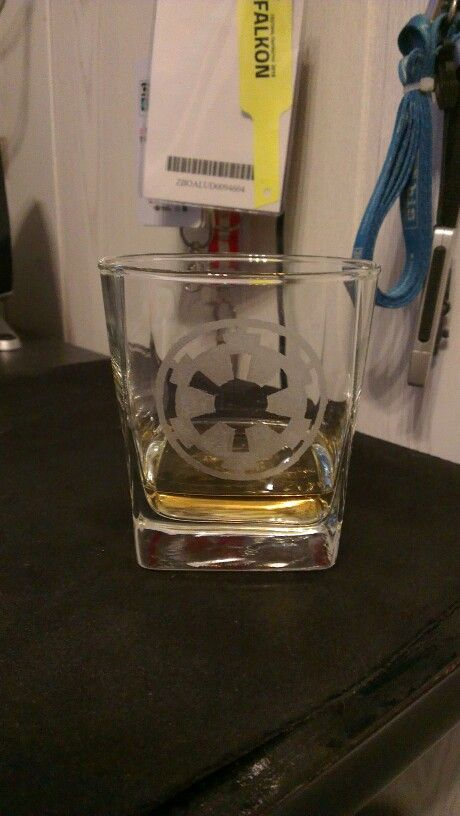 Whisky glass with Empire logo