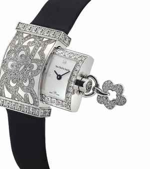 VAN CLEEF & ARPELS. A LADY'S VERY FINE 18K WHITE GOLD AND DIAMOND-SET RECTANGULAR WRISTWATCH WITH CONCEALED MOTHER-OF-PEARL DIAL