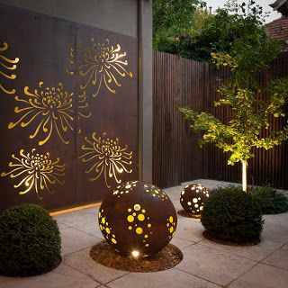 CORTEN STEEL... love the steel globe lights...