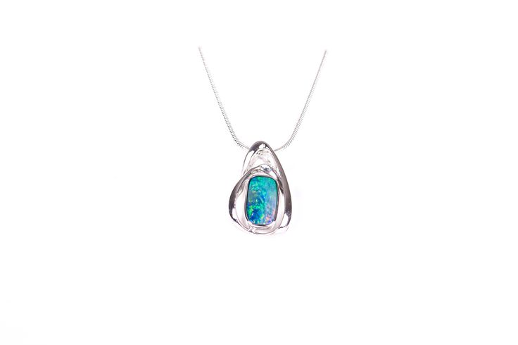 Our stylish Doublet Opal Pendant necklace set in Sterling Silver is blueish green in colour with a fleck of pink in the corner.