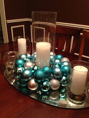 A quick, easy, DIY Christmas wreath or centerpiece made from silver and aqua blue Christmas ornaments....