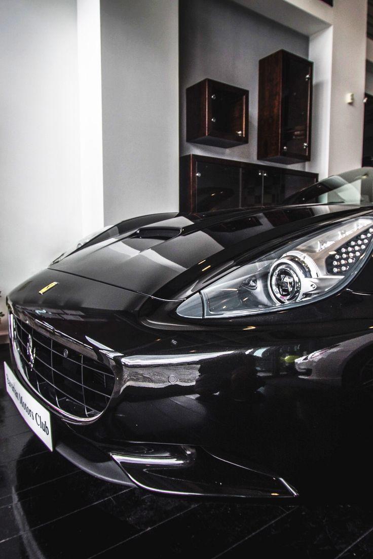 Luxury caravan with full size sports car garage from futuria - Ferrari California