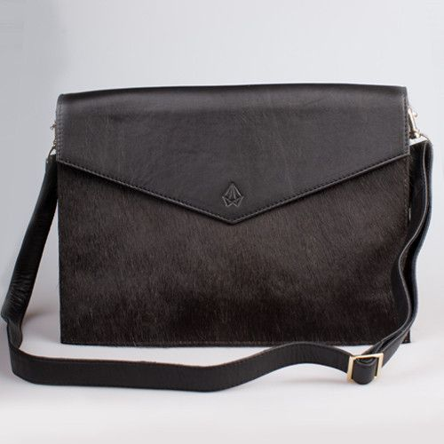 Roma brings together the best of both worlds to create a majestic handbag perfect for any goddess. The furry and the sturdy combine beautifully in this fold over handbag that features invisible magnetic fastening, fabric lining, cellphone pocket, internal zip pocket and detachable/adjustable strap. She can be worn over the shoulder, across the chest or carried as a clutch. Strong and determined, Roma is for the goddess on a mission to conquer the world!