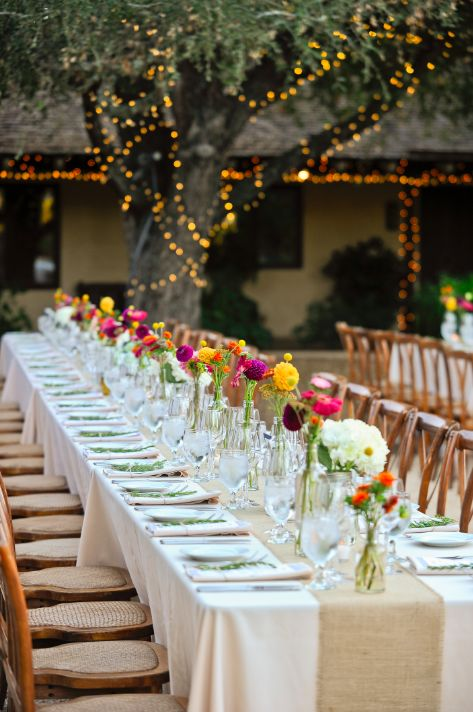 Tiny vases everywhere, long table decorations.