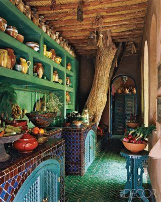 The counter and floor tiles in the kitchen were locally crafted in Morocco and the cabinets are fitted with Musharabi screens, but we could probably do a cheap, DIY version of that tiled floor?