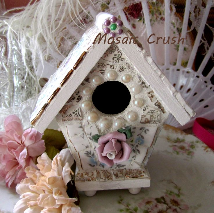 Beautiful gold details on this birdhouse. Handcrafted with vintage china.