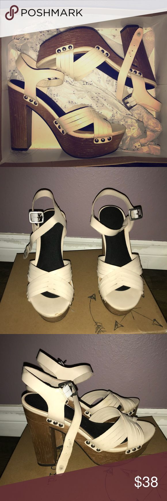 Cream strappy heels open toed strappy heels, Wood like heels, cream colored.Studs on the side of heel. Shoes Heels