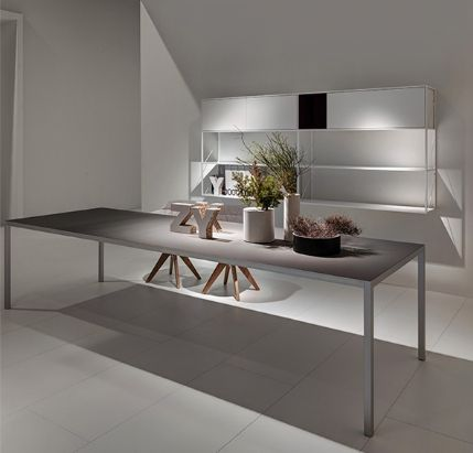 MDF Italia LIM 3.0 table  Lim 3.0, a makeover of the LIM iconic family, renews and turns into a light and thin table, with a more up-to date and modern identity. The structure contained in the sections can receive different materials to offer an alternative option to monochromatism and single material structure.  http://www.industryinterior.com/en/prod/living-room/table/mdf-italia-lim-3-0-table-472.html