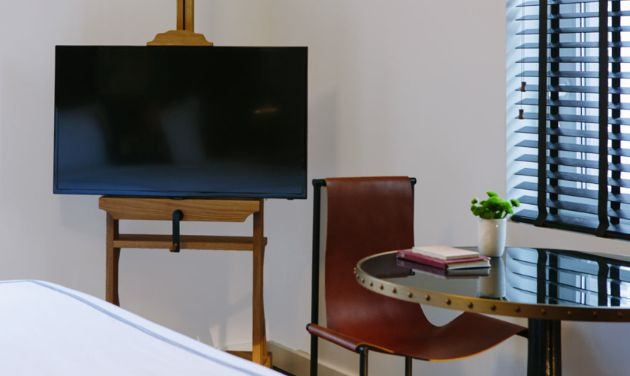 The Palladian - new family-friendly boutique hotel Seattle. Love the use of an easel to hold the flat screen.