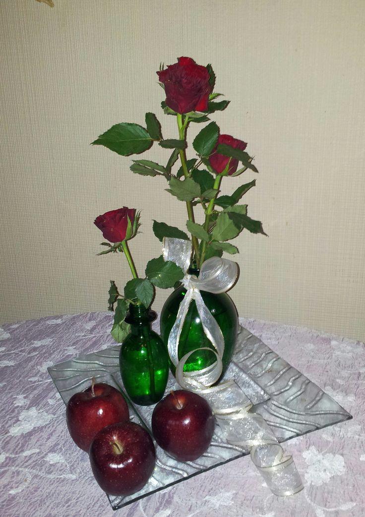 røde epler som matcher røde roser