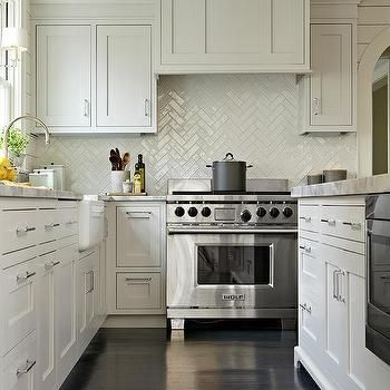 Gray Shaker Kitchen Cabinets with Dark Stained Wood Floors and White Chevron Tiles