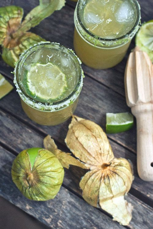 Tomatillo Margaritas makes 4 cocktails Simple Syrup 1/2 cup sugar 1/2 cup cold water Bring the water and sugar to a boil until sugar dissolves. Let cool completely.  Rim 2 tbsp coarse salt zest from 2 limes (use the limes you're going to juice) Stir the lime zest and salt together.   Cocktail simple syrup 2 small tomatillos 4 limes 4 oz white tequila crushed ice
