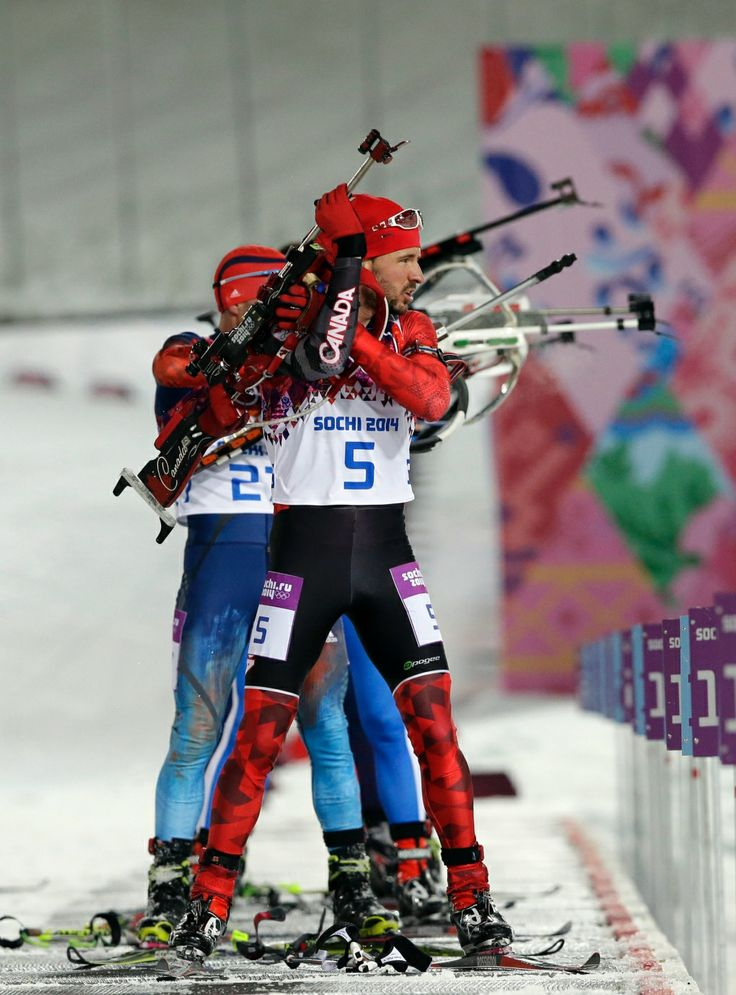Photos: Canada at Sochi Games - Day 3 | CTV News at Sochi 2014 ~~ Canada's Jean-Philippe le Guellec prepares to shoot during the men's biathlon 12.5k pursuit. Feb. 10